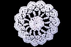 Cream round lace tablecloth isolated on black background. Cute out and texture for design. White pattern doily Stock Photos