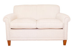 Cream sofa white background Stock Images