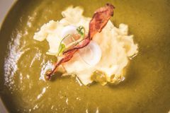 Cream of sorrel and green vegetables soup Stock Images