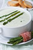 Cream soup of asparagus close-up and croutons. Royalty Free Stock Photo