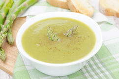 Cream soup of asparagus and green peas with toasted bread Royalty Free Stock Images