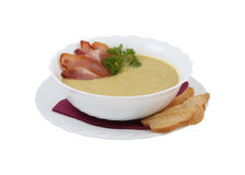 Cream soup with bacon and croutons Stock Image