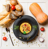 Cream soup and bread Stock Image