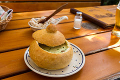 Cream soup in a bread bowl Stock Images