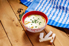 Cream soup and bread croutons Royalty Free Stock Photography