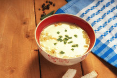 Cream soup, bread croutons and towel Stock Photos