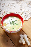 Cream soup and bread croutons Stock Images