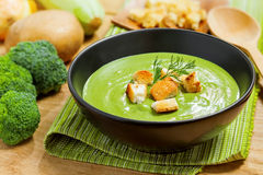 Cream soup. Broccoli cream soup and ingredients on table Royalty Free Stock Images