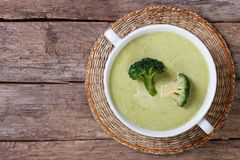 Cream soup of broccoli on the table top view Stock Image