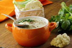 Cream soup of cauliflower with black pepper Royalty Free Stock Photography