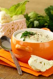Cream soup of cauliflower with black pepper Royalty Free Stock Photo