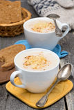 Cream soup of cauliflower with cheese in a cups Stock Photo