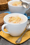 Cream soup of cauliflower with cheese in a cups, vertical Royalty Free Stock Image