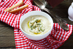 Cream soup with celery and pumpkin seeds in a bowl Stock Photos