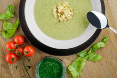 Cream soup with cherry tomatoes Royalty Free Stock Images