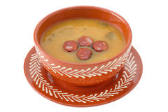 Cream soup with cut sausage Royalty Free Stock Photos