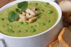 Cream soup with green peas with croutons closeup Stock Photo