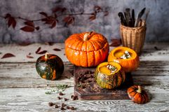 Cream Soup in Hollowed Pumpkins. Pumpkin Cream Soup in Hollowed Pumpkin Bowls, copy space for your text Royalty Free Stock Images