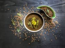 Cream soup lentil on black background, delicious vegetarian food. Top view . royalty free stock image