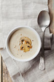 Cream soup with mushrooms champignon and potato in white bowl. Vintage style, top view royalty free stock image