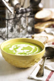 Cream soup with potato and green peas Royalty Free Stock Image