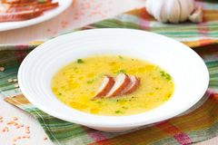 Cream soup of red lentil with smoked meat, duck, chicken Royalty Free Stock Image