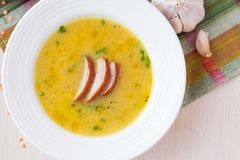 Cream soup of red lentil with smoked meat, duck, chicken Royalty Free Stock Photography