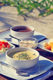 Cream soup served with fresh vegetables and fruits Royalty Free Stock Image