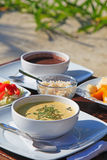 Cream soup served with fresh vegetables and fruits Stock Photo