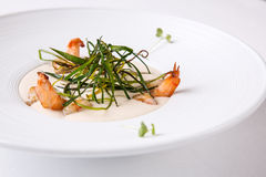 Cream soup with shrimps Stock Photos