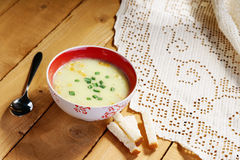 Cream soup, spoon and bread croutons Stock Photos