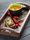 Cream-soup from tomatoes and baked pepper, with a multi-grain bread with smoked suluguni stock images