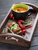 Cream-soup from tomatoes and baked pepper, with a multi-grain bread with smoked suluguni stock photography
