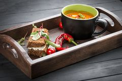 Cream-soup from tomatoes and baked pepper, with a multi-grain bread with smoked suluguni royalty free stock images