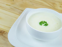 Cream soup in white bowl on wooden table Royalty Free Stock Image