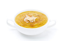 Cream soup of yellow lentils in a bowl, isolated Royalty Free Stock Photography