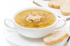 Cream soup of yellow lentils with bread, close-up, isolated Stock Photography