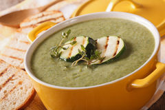 Cream soup of zucchini with herbs close-up in a saucepan. horizontal. Cream soup of zucchini with thyme close-up in a saucepan. horizontal stock photos