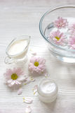 Cream and spa on wooden background with flowers Stock Image