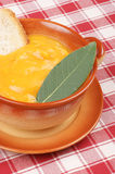 Cream of squash soup in a casserole pot Royalty Free Stock Photography