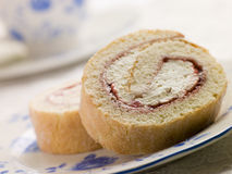 Cream and Strawberry Sponge Roll with Tea Royalty Free Stock Images