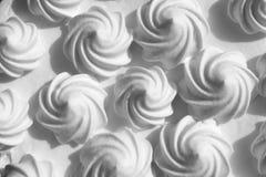 Festive curls for white meringue cream cake royalty free stock photography