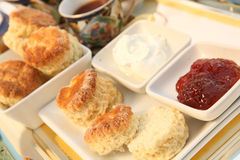 Cream tea 4. A traditional British cream tea, with scones (biscuits), strawberry jam, cream and tea Stock Photography
