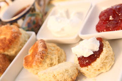 Cream tea 5. A traditional British cream tea, with scones, jam, cream and a cup of tea Stock Photos
