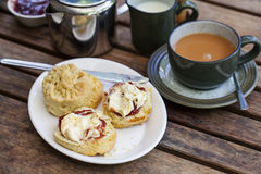 Cream tea. Traditional cream tea with scone, clotted cream and jam Royalty Free Stock Photography