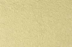 Cream textured paper. Closeup, can be used as a background Stock Photography