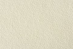 Cream textured paper. Cream textured paper on macro. High resolution photo Royalty Free Stock Photography
