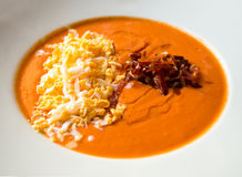 Cream of tomato with ham and egg Stock Images