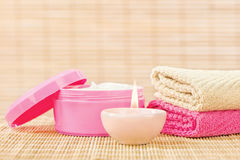 Cream, towels and candle Royalty Free Stock Image