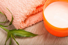 Cream and towels for spa Royalty Free Stock Images